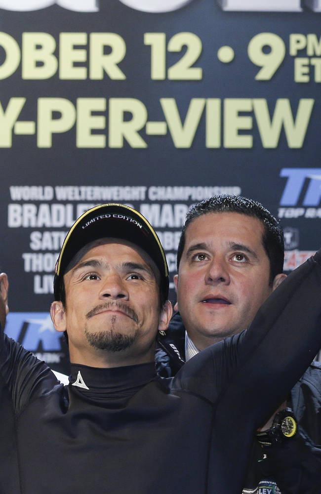 Juan Manuel Marquez waves to boxing fans before weighing in for his WBO welterweight title fight against Timothy Bradley, Friday, Oct. 11, 2013, in Las Vegas. Marquez will challenge Bradley for the title on Saturday