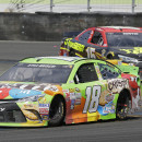 Kyle Busch (18) leads Clint Bowyer through Turn 11 during the NASCAR Sprint Cup Series auto race Sunday, June 28, 2015, in Sonoma, Calif. Busch won the race and Bowyer took third place. (AP Photo/Eric Risberg)