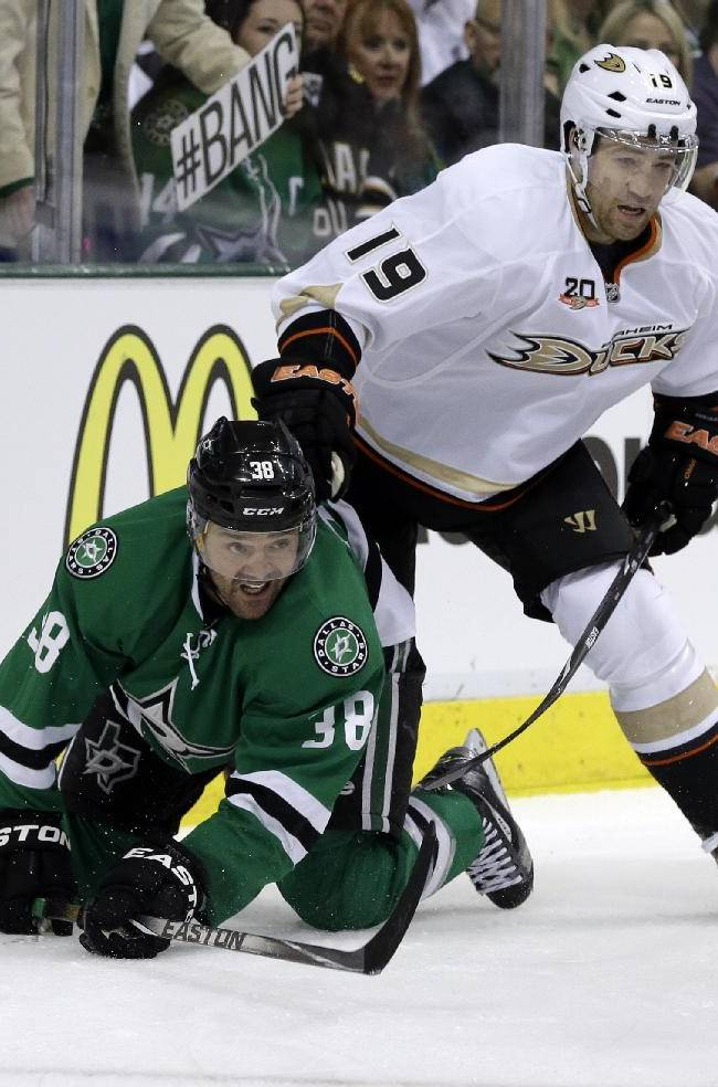 Dallas Stars' Vernon Fiddler (38) fights off pressure from Anaheim Ducks' Stephane Robidas (19) as the two chase a loose puck in the first period of Game 3 of a first-round NHL hockey Stanley Cup playoff series game, Monday, April 21, 2014, in Dallas