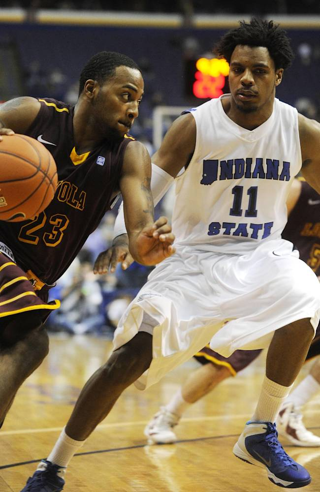 Loyola of Chicago's Jeff White (23) drives around Indiana State's Devonte Brown (11) during the second half of an NCAA college basketball game in the quarterfinals of the Missouri Valley Conference men's tournament, Friday, March 7, 2014, in St. Louis