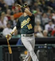 Oakland Athletics' Josh Reddick hits a two-run home run in the eighth inning against the Houston Astros during a baseball game on Monday, July 22, 2013, in Houston. (AP Photo/Bob Levey)