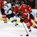 Chicago Blackhawks defenseman Nick Leddy (8) takes control of the puck from the San Jose Sharks during the first period of an NHL hockey game on Sunday, Nov. 17, 2013, in Chicago The Associated Press