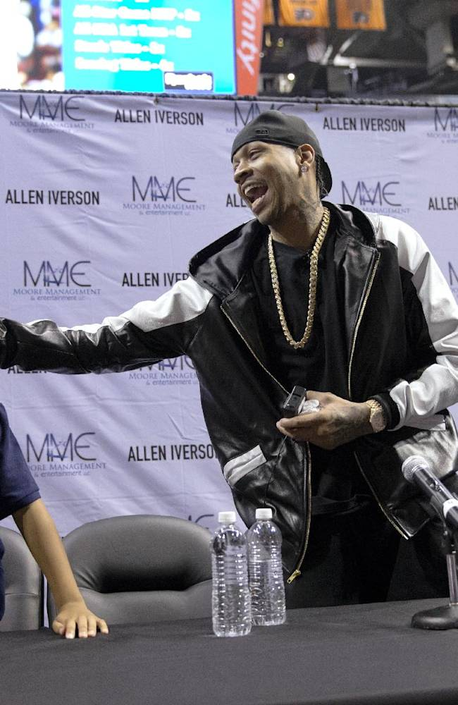 Former Philadelphia 76ers Allen Iverson, accompanied by his son Isaiah, 7, and daughter Messiah, 10, leaves a news conference Wednesday, Oct. 30, 2013, in Philadelphia. Iverson officially retired from the NBA, ending a 15-year career during which he won the 2001 MVP award and four scoring titles. Iverson retired in Philadelphia where he had his greatest successes and led the franchise to the 2001 NBA finals