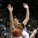 BYU's Brandon Davies shoots over Mercer's Daniel Coursey (52) during a second-round game of the NIT college basketball tournament on Monday, March 25, 2013, in Provo, Utah. (AP Photo/The Deseret News, Tom Smart)