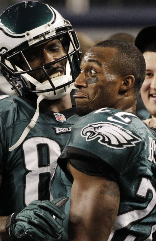 Philadelphia Eagles wide receiver Jason Avant (81) and Brandon Boykin (22) celebrate their 24-22 win over the Dallas Cowboys after an NFL football game, Sunday, Dec. 29, 2013, in Arlington, Texas