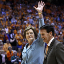 Tennessee head coach emeritus Pat Summitt waves to fans as she walks with athletic director Dave Hart before a banner is be raised in her honor before an NCAA college basketball game against Notre Dame on Monday, Jan. 28, 2013, in Knoxville, Tenn. (AP Photo/Wade Payne)