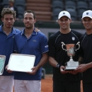 Bob, second right,  and Mike Bryan, of the U.S, pose for photographers  with the trophy as France's Michael Llodra, second left,  and Nicolas Mahut, left, hold their plate after the men's double final match of the French Open tennis tournament at the Roland Garros stadium Saturday, June 8, 2013 in Paris. (AP Photo/David Vincent)