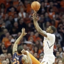 Illinois guard Brandon Paul, right, shoots against Auburn guard Frankie Sullivan during the first half of an NCAA college basketball game in Chicago, Saturday, Dec. 29, 2012. (AP Photo/Nam Y. Huh)