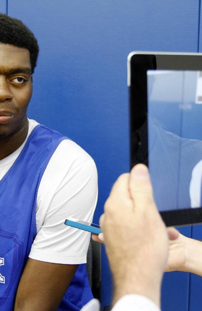 Kentucky's Dakari Johnson answers a question during the NCAA men's college basketball team's media day Tuesday, Oct. 15, 2013, in Lexington, Ky
