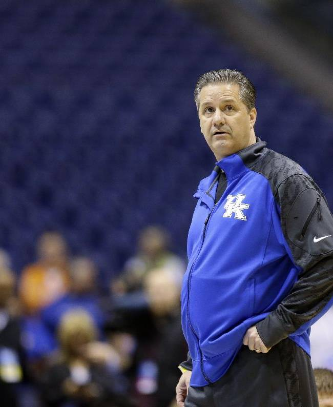 Kentucky head coach John Calipari looks around during practice for the NCAA Midwest Regional semifinal college basketball tournament game Thursday, March 27, 2014, in Indianapolis. Kentucky plays Louisville on Friday, March 28, 2013