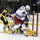 New York Rangers left wing Rick Nash (61) shoots the puck past Pittsburgh Penguins goalie Marc-Andre Fleury (29) to score as Penguins defenseman Brian Dumoulin (8) looks on in the second period of an NHL hockey game at Madison Square Garden on Monday, De