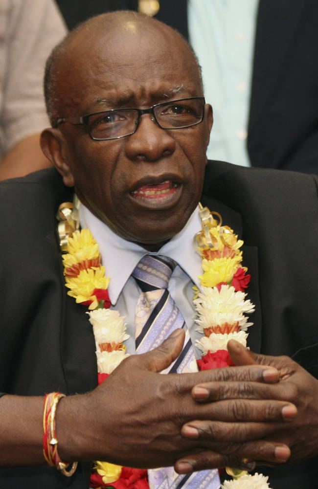 In this Thursday, June 2, 2011 file photo, suspended FIFA executive Jack Warner gestures during a news conference held shortly after his arrival at the airport in Port-of-Spain, in his native Trinidad and Tobago. Organizers of the 2022 World Cup in Qatar have distanced themselves from fresh allegations of corruption surrounding the Gulf nation's winning bid for the tournament in 2010. The Tuesday March 18, 2014  edition of British newspaper The Daily Telegraph alleges it has evidence that former FIFA vice president Jack Warner and his family were paid almost $2 million from a company controlled by Mohamed Bin Hammam, a Qatari who used to be an executive committee member of world football's governing body