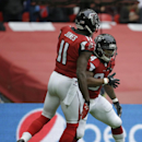 Atlanta Falcons running back Devonta Freeman (24) celebrates a touchdown with wide receiver Julio Jones (11) in the first half of the NFL football game against the Detroit Lions at Wembley Stadium, London, Sunday, Oct. 26, 2014 The Associated Press