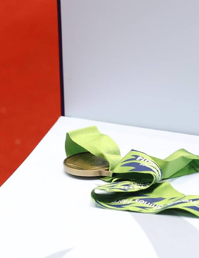 A bronze medal is lying on the podium that was rejected by India's L. Sarita Devi during the medal ceremony for the women's light 60-kilogram division boxing at the 17th Asian Games in Incheon, South Korea, Wednesday, Oct. 1, 2014. India's protest against the outcome of an Asian Games boxing semifinal that was awarded to South Korea's Park Ji-na over Devi in the women's 60-kilogram division was rejected on Tuesday. Devi rejected her medal in protest against the result