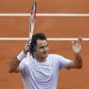 Switzerland's Roger Federer acknowledges the crowd after his first round match of the French Open tennis tournament against Spain's Pablo Carreno Busto, at Roland Garros stadium in Paris, Sunday, May 26, 2013. (AP Photo/Petr David Josek)