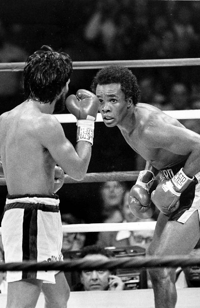 In this Nov. 25, 1980 file photo, Sugar Ray Leonard, right, taunts at Roberto Duran in the ring during a WBC Welterweight Championship fight refereed by Octavio Meyran in New Orleans, La.  Leonard won the rematch fight and the title in the eighth round. ESPN Films launched a documentary called