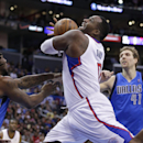 Los Angeles Clippers' Glen Davis drives between Dallas Mavericks' Jae Crowder, left, and Dallas Mavericks' Dirk Nowitzki during the first half of an NBA basketball game on Thursday, April 3, 2014, in Los Angeles The Associated Press