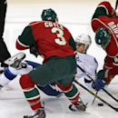 Tampa Bay Lightning center Valtteri Filppula, center, of Finland, gets upended in a battle for puck control with Minnesota Wild center Charlie Coyle, left, and Mikko Koivu of Finland in the first period of an NHL hockey game, Saturday, Oct. 25, 2014, in S
