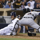 San Diego Padres' Andrew Cashner beats the tag by Detroit Tigers catcher Alex Avila during the seventh inning of a baseball game Friday, April 11, 2014, in San Diego The Associated Press