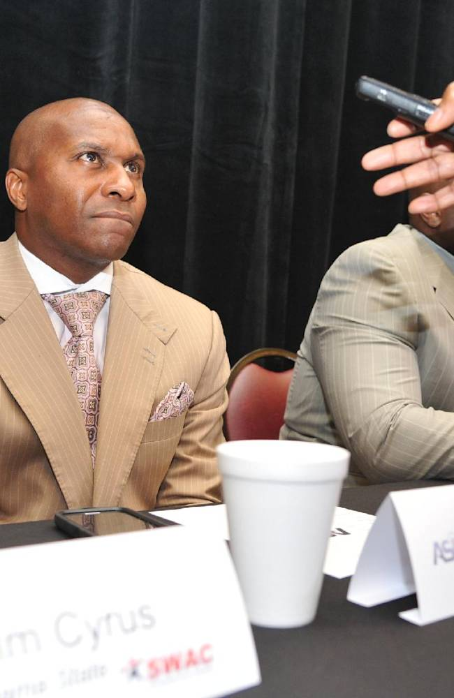 Alabama State head coach Reggie Barlow answers questions from the media during the Southwestern Athletic Conference NCAA college football media day Friday, July 18, 2014, in Birmingham, Ala