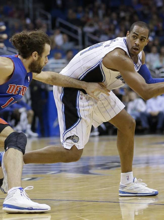 Orlando Magic's Arron Afflalo, right, looks for a way around Detroit Pistons' Luigi Datome, of Italy, during the second half of an NBA basketball game in Orlando, Fla., Friday, Dec. 27, 2013. Orlando won 109-92
