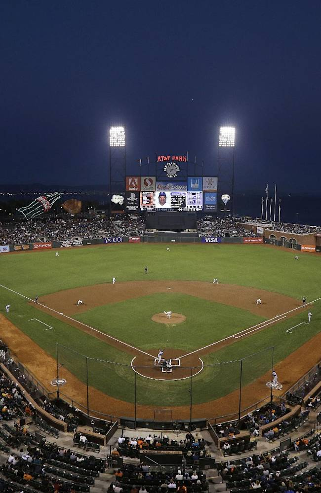 The San Francisco Giants play the Los Angeles Dodgers at AT&T Park during the first inning of a baseball game in San Francisco, Tuesday, Sept. 24, 2013
