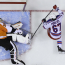 Philadelphia Flyers' Steve Mason, left, blocks a shot by New York Rangers' Benoit Pouliot during the first period of an NHL hockey game, Saturday, March 1, 2014, in Philadelphia. Philadelphia won 4-2 The Associated Press