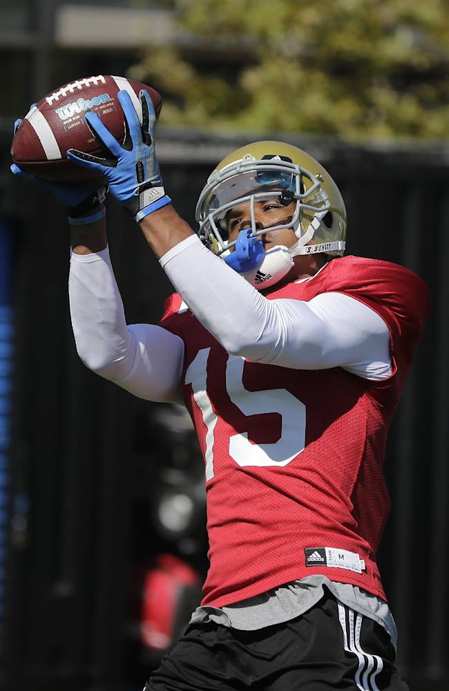 UCLA wide receiver Devin Lucien makes a catch during NCAA college football practice Wednesday, Aug. 20, 2014, in Los Angeles