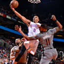 PHOENIX, AZ - FEBRUARY 26: Russell Westbrook #0 of the Oklahoma City Thunder shoots against Marcus Morris #15 and Markieff Morris #11 of the Phoenix Suns on February 26, 2015 at U.S. Airways Center in Phoenix, Arizona. (Photo by Barry Gossage/NBAE via Getty Images)