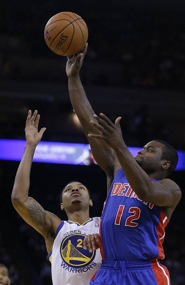 Detroit Pistons' Will Bynum, right, shoots over Golden State Warriors' Kent Bazemore (20) during the first half of an NBA basketball game on Tuesday, Nov. 12, 2013, in Oakland, Calif
