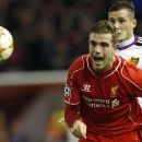 Liverpool's Jordan Henderson shouts out as he chases the ball during the Champions League Group B soccer match between Liverpool and FC Basel at Anfield Stadium in Liverpool, England, Tuesday, Dec. 9, 2014