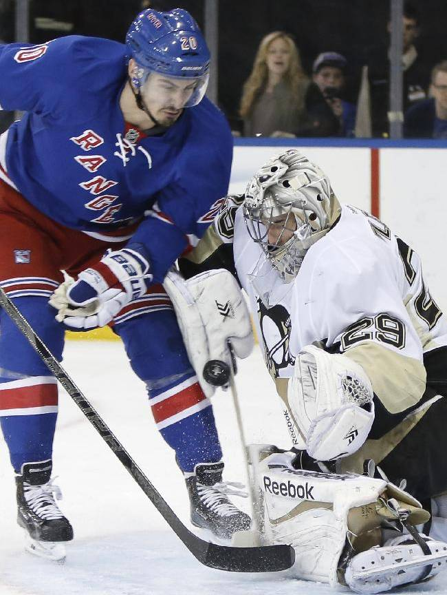 New York Rangers left wing Chris Kreider (20) collides with Pittsburgh Penguins goalie Marc-Andre Fleury (29) in the second period of Game 6 of an NHL hockey second-round hockey playoff series, Sunday, May 11, 2014, in New York.  Kreider was penalized for goalie interference for the play