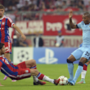 Bayern's Xabi Alonso, left, and Manchester City's Fernandinho challenge for the ball during the Champions League group E soccer match between Bayern Munich and Manchester City in Munich, Germany, Wednesday Sept.17,2014