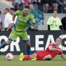 Seattle Sounders forward Clint Dempsey, left, is defended by San Jose Earthquakes midfielder Sam Cronin during the first half of an MLS soccer match Saturday, Aug. 2, 2014, in Santa Clara, Calif The Associated Press