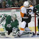 Dallas Stars goalie Kari Lehtonen (32) grabs the puck as teammate defenseman Trevor Daley (6) tires to tie up Philadelphia Flyers right wing Jakub Voracek (93) during the first period of an NHL hockey game Saturday, Oct. 18, 2014, in Dallas The Associate