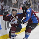 Colorado Avalanche center Paul Stastny (26) celebrates his game winning goal against the Minnesota Wild with Tyson Barrie (4) during the fourth period in Game 1 of an NHL hockey first-round playoff series on Thursday, April 17, 2014, in Denver. Colorado beat Minnesota 5-4 in overtime. (AP Photo/Jack Dempsey)