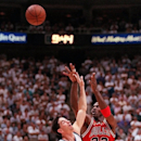 Chicago Bulls Michael Jordan makes his final 3-point shot over the top of Utah Jazz's John Stockton during the fourth quarter of Game 5 of the NBA Finals Wednesday, June 11, 1997, in Salt Lake City. Jordan, suffering from flu symptoms, scored 38 to help