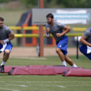 Indianapolis Colts quarterbacks Andrew Luck, left, Chandler Harnish, center, and Matt Hasselbeck run a drill during an NFL football training camp in Anderson, Ind., Saturday, July 26, 2014 The Associated Press
