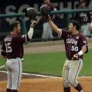 Texas A&M's Hunter Melton (50) is congratulated at home plate by teammate Daniel Mengden (15) after hitting a second-inning home run  in their Southeastern Conference Tournament college baseball game against Vanderbilt at the Hoover Met in Hoover, Ala., Wednesday, May 22, 2013. (AP Photo/Dave Martin)