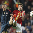 Bayern's Bastian Schweinsteiger, left, and Manchester United's Michael Carrick challenge for the ball during the Champions League quarterfinal first leg soccer match between Manchester United and Bayern Munich at Old Trafford Stadium, Manchester, England,