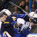 St. Louis Blues right wing T.J. Oshie (left) reacts after being hit in the face as he jostles with Toronto Maple Leafs defenseman Cody Franson in third period action during a game between the St. Louis Blues and the Toronto Maple Leafs on Thursday Dec. 12