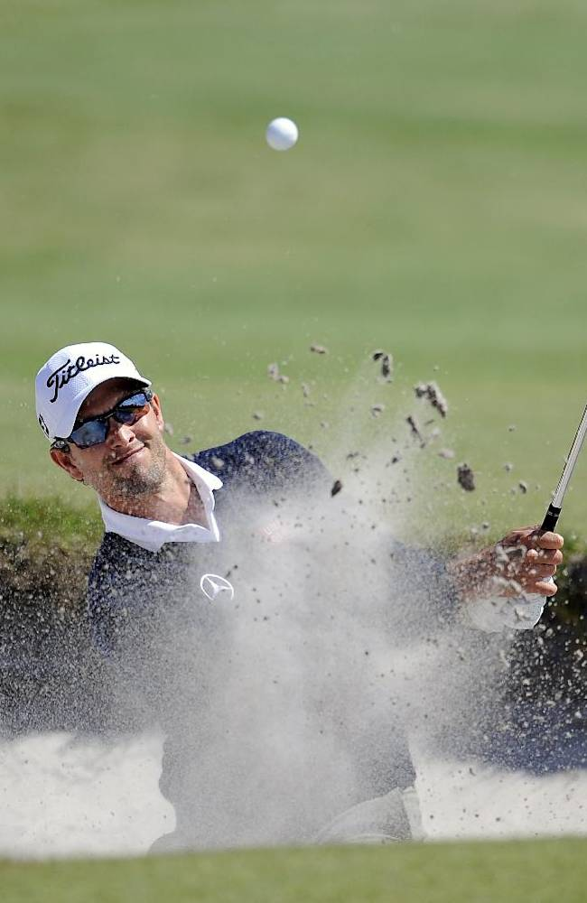Adam Scott of Australia hits out of a bunker on the 15th hole during the final round of the World Cup of Golf at Royal Melbourne Golf Course in Australia, Sunday, Nov. 24, 2013