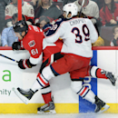 Ottawa Senators' Mark Stone gets hit into the boards by Columbus Blue Jackets' Michael Chaput during first period NHL hockey action in Ottawa, Ontario, on Saturday, Oct. 18, 2014 The Associated Press