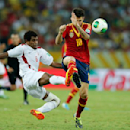 Tahiti's Henri Caroine, left, and Spain's Cesc Fabregas challenges for the ball during the soccer Confederations Cup group B match between Spain and Tahiti at Maracana stadium in Rio de Janeiro, Brazil, Thursday, June 20, 2013. (AP Photo/Victor R. Caivano)