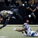 New Orleans Saints tight end Jimmy Graham (80) is upended by Carolina Panthers cornerback Josh Norman on a reception in the first half of an NFL football game in New Orleans, Sunday, Dec. 7, 2014 The Associated Press