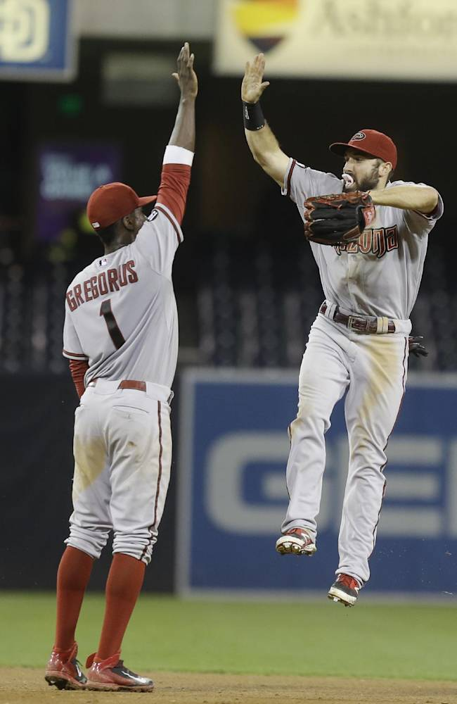 Arizona Diamondbacks' Adam Eaton gets up in the air to high five Didi Gregorius  after the Diamondbacks 2-1 victory over the San Diego Padres in a twelve inning baseball game Tuesday, Sept. 24, 2013, in San Diego