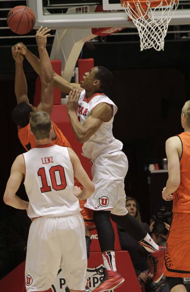 Idaho State Bengals forward Jeffrey Solarin (5) gets the ball slapped away by Utah Utes guard/forward Princeton Onwas (3). University of Utah defeated Idaho State Bengals74-66, Dec. 10, 2013 at the Huntsman Center