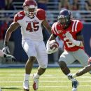 FILE - In this Oct. 22, 2011 file photo, Mississippi wide receiver Nickolas Brassell (2) and Arkansas linebacker Alonzo Highsmith (45) participate in an NCAA college football game in Oxford, Miss. Highsmith is being counted on as a key part of Arkansas' defense in the 2012 season. (AP Photo/Rogelio V. Solis, File)
