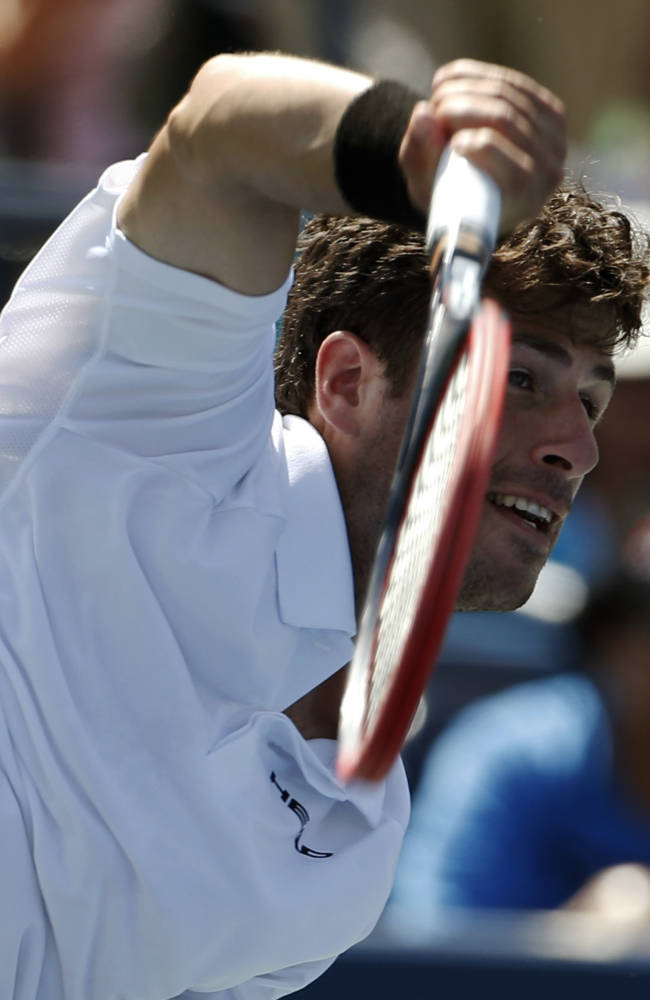 Robin Haase, of the Netherlands, serves against Andy Murray, of the United Kingdom, during the opening round of the 2014 U.S. Open tennis tournament, Monday, Aug. 25, 2014, in New York