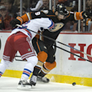 The Ducks' Patrick Maroon, right, controls the puck as he is tangled with the Rangers' Dan Boyle during a game in Los Angeles on Wednesday night Jan. 7, 2014 The Associated Press
